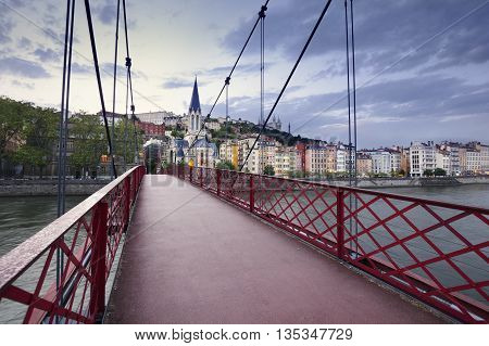 Footbridge And View Of Old City Of Lyon At Sunset, France