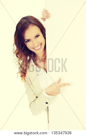 Business woman pointing on empty banner.