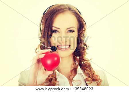 Call center woman with heart toy.