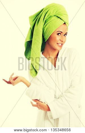 Woman in bathrobe looking at camera