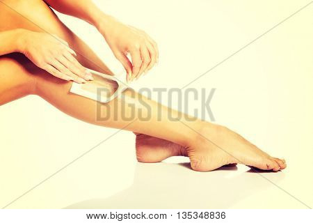 Woman waxing her leg