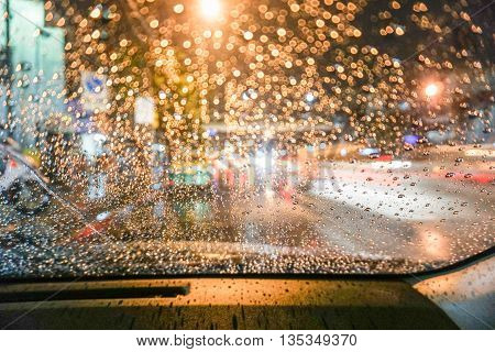 Bokeh Raindrops on the wind shield during driving