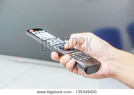 Turn on the TV by a remote control