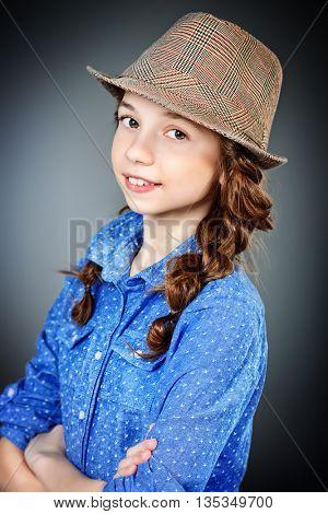 Cute smiling girl with braids. Studio shot.