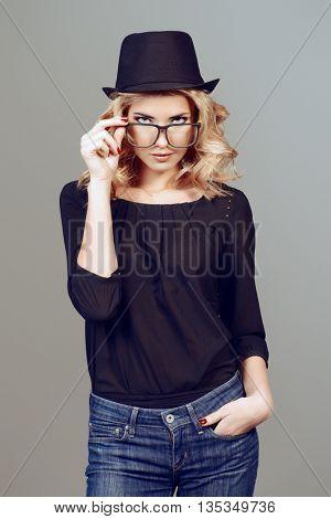Portrait of a young woman with beautiful blonde hair wearing glasses. Optics. Eyewear style.