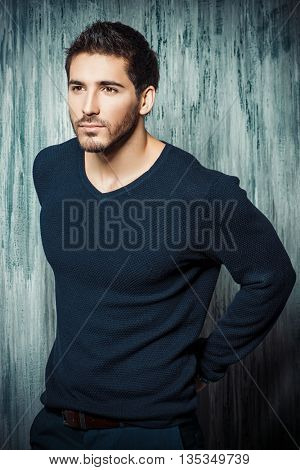 Handsome young man posing at studio. Men's beauty.