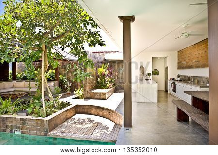 Outside Patio Area With Trees In The Garden And Kitchen