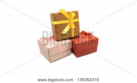 Little red, gold brown and pink gift boxs on white background