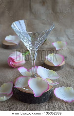 empty martini glass and rose petals on the table
