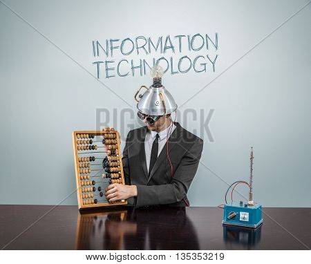 Information technology concept with businessman and abacus
