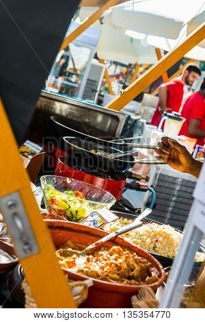 Delicious african dish on a outdoor table. Street food photography.