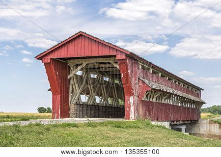 Built in 1868 the red Culbertson Covered Bridge also know as Winget Road Covered Bridge spans Treacle Creek in rural Union County Ohio.