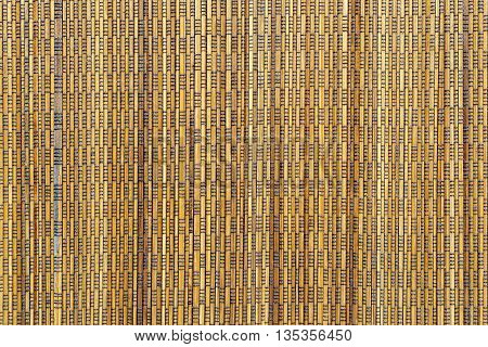 abstract vertical pattern of a cover from wooden straws for the textured background and for wallpaper of sand color