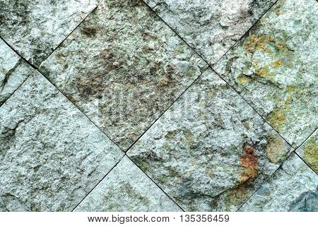 close up runge stone wall texture background.