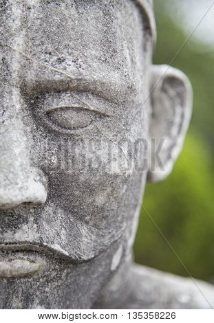 Close up of fhe face of stone statue, Vietnamese sculptures guarding the tomb of the late Kings