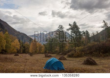 Tourist camp in the autumn mountain valley