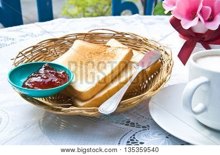 toast and jam strawberry in breakfast on table