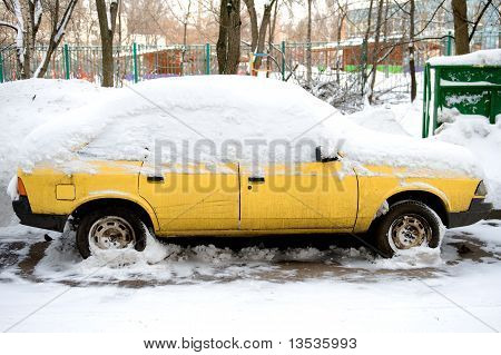 Parked Car And Snow Close Up