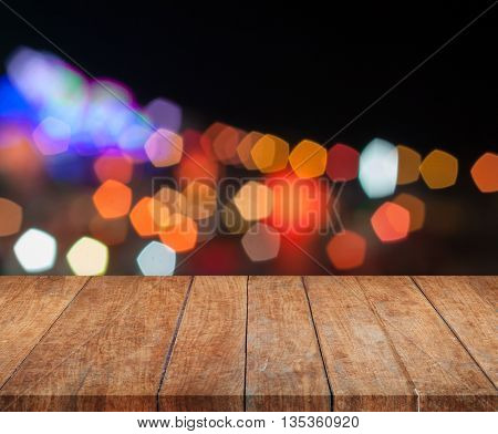 Top wooden with abstract blurred night lights, stock photo