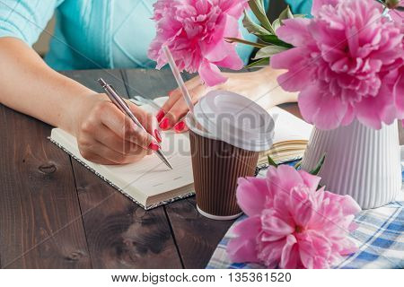Woman Write In Notebook, Flowers On Table