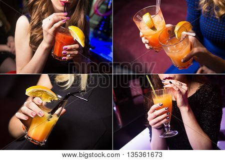 an alcoholic orange cocktails is in beautiful glassin hands