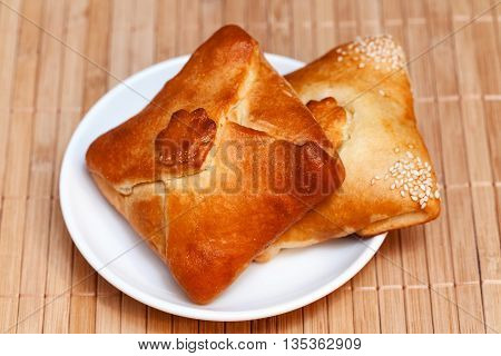 Pasties Stuffed Meat On Bamboo Napkin, Close Up