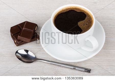 Black Coffee, Pieces Of Chocolate And Spoon On Table