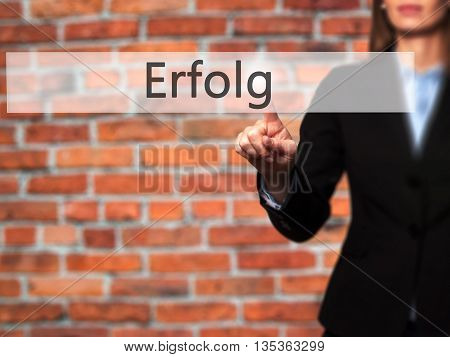 Erfolg (success) - Businesswoman Hand Pressing Button On Touch Screen Interface.