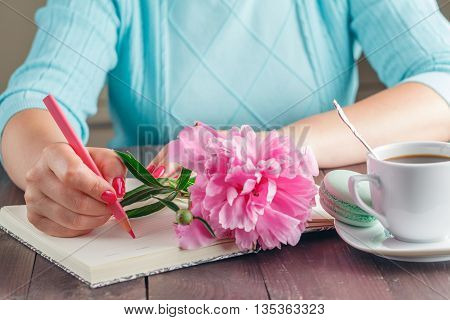 Woman With Peony Flower On Kitchen With Coffee