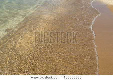 Golden Sands black sea. Sea bottom texture, yellow sand waves in shallow water