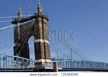 The John A. Roebling Bridge connects Cincinnati, Ohio and Covington, Kentucky over the Ohio river.