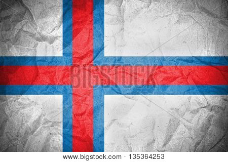 Faroe Islands Flag on crumpled paper texture background
