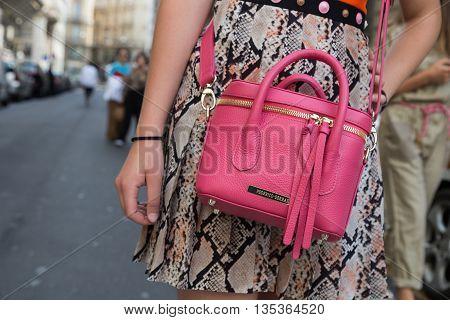 MILAN ITALY - JUNE 19: Detail of bag outside Ferragamo fashion show building during Milan Men's Fashion Week on JUNE 19 2016 in Milan.