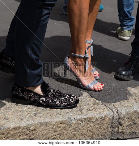 MILAN ITALY - JUNE 19: Detail of shoes outside Ferragamo fashion show building during Milan Men's Fashion Week on JUNE 19 2016 in Milan.