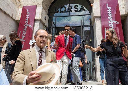MILAN ITALY - JUNE 19: Fashionable people gather outside Ferragamo fashion show building during Milan Men's Fashion Week on JUNE 19 2016 in Milan.