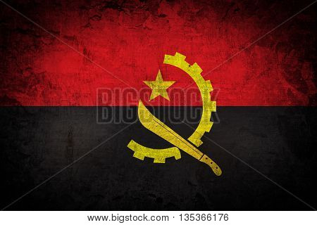 Angola Flag painted on old brick wall texture background
