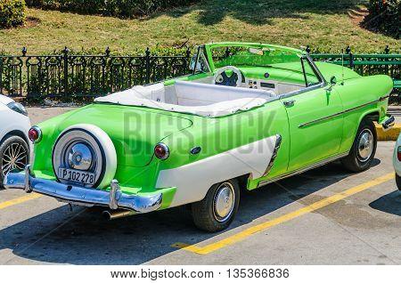 HAVANA, CUBA - MARCH 16, 2016: Green luxury car in the Old Havana neighborhood Cuba