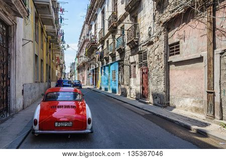 HAVANA, CUBA - MARCH 16, 2016: Oldtimer car parked in the Old Havana neighborhood Cuba
