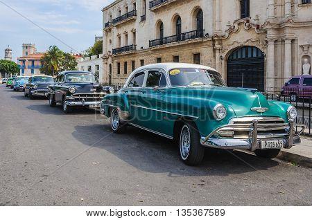 HAVANA, CUBA - MARCH 16, 2016: Colorful oldtimer parked in the Old Havana neighborhood Cuba
