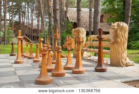 Huge Chess pieces on a chessboard in the park