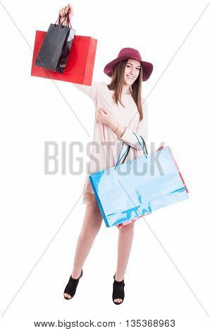 Cheerful Beautiful Girl In Trendy Outfit Rising Up Shopping Bags