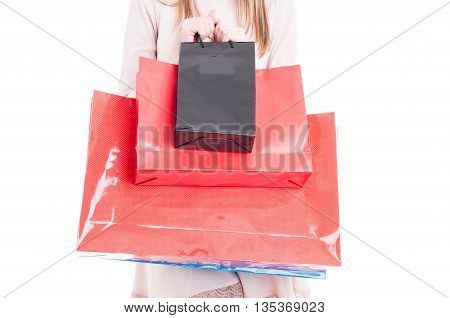 Close-up Of Paper Shopping Bags In Young Shopper Hand