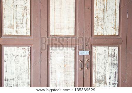 close-up image of wood door in Thai home