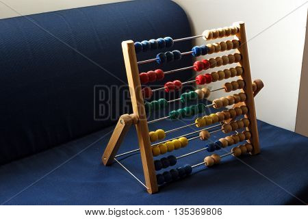 An abacus with colourful beads arranged randomly