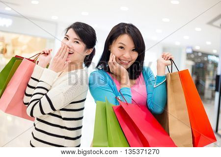 Two girls go shopping together