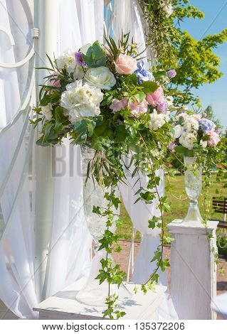 elegant bouquet of roses and hydrangeas on a background of light curtains