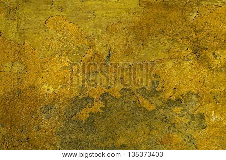 Old yellow dirty uneven weathered cement wall texture background