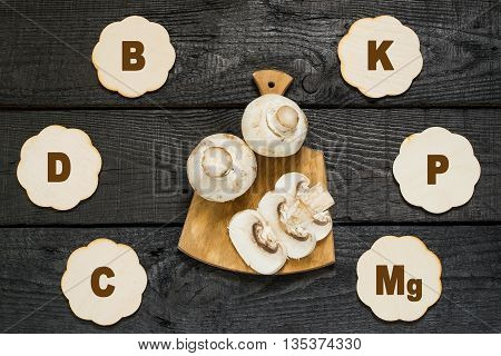 Fresh champignon on a cutting board. The source of vitamins A C PP group B protein minerals amino acids. Diet health or vegetarian food concept