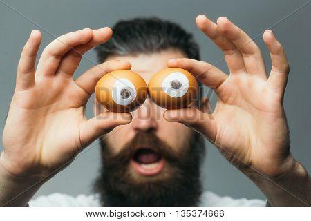 Emotional Bearded Man With Egg Eyes