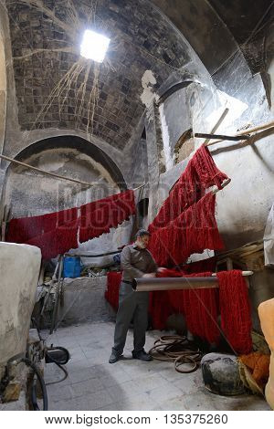 KASHAN IRAN - APRIL 20: colored yarn in market (Bazaar) in Kashan Iran on April 20 2015. Bazaar of Kashan is the most important tourist attraction in Kashan Iran.